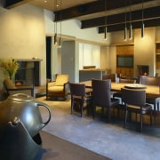 Image of the lounge, dining and kitchen. All furniture, interior design, lobby, table, black