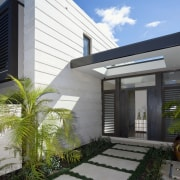 Exterior view of the entrance way featuring cladding, architecture, building, elevation, facade, home, house, property, real estate, residential area, gray