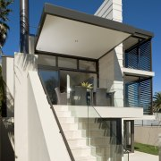 Exterior view of rear of the house which architecture, building, facade, house, residential area, roof, white