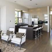 View of the kitchen area which faces into floor, flooring, interior design, living room, property, real estate, room, gray