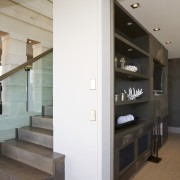 View of a stairway with a glass ballustarde interior design, white