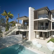 Exterior view of house which features pool, cladding, apartment, architecture, elevation, estate, facade, family car, home, house, property, real estate, residential area, swimming pool, villa