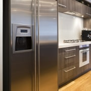 View of a kitchen which features appliances from countertop, home appliance, kitchen, kitchen appliance, major appliance, refrigerator, gray
