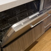 View of the Smeg STH905 dishwasher available from cabinetry, countertop, drawer, floor, flooring, furniture, home appliance, kitchen, kitchen appliance, major appliance, wood, brown, black