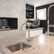 Kitchen has Granite tops and contrasting dark walnut countertop, floor, flooring, interior design, kitchen, gray
