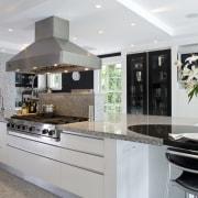 Kitchen has Granite tops and contrasting dark walnut countertop, cuisine classique, interior design, kitchen, gray