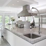 Kitchen has Granite tops and contrasting dark walnut countertop, interior design, kitchen, real estate, gray, white