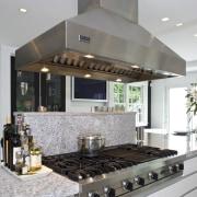 Kitchen has Granite tops and contrasting dark walnut countertop, interior design, kitchen, gray