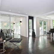 A shot of the white painted contemporary minimalist ceiling, floor, flooring, hardwood, home, interior design, laminate flooring, living room, property, real estate, room, wood flooring, gray, white