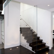 View of a stairway with glass balustrade and floor, flooring, glass, handrail, interior design, stairs, wall, white