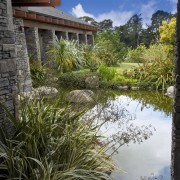 View of concrete rock pool which is made estate, garden, grass, home, landscape, landscaping, plant, property, real estate, reflection, water, black