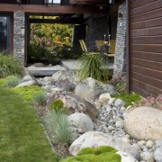 View of the rear of the house where backyard, garden, grass, landscape, landscaping, lawn, outdoor structure, plant, pond, walkway, yard, gray
