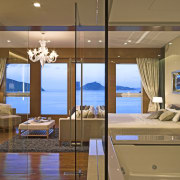 Master suite in a Hong Kong waterside apartment.Featuring ceiling, interior design, room, suite, brown