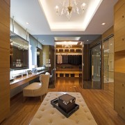 Master suite in a Hong Kong waterside apartment.Featuring architecture, cabinetry, ceiling, estate, floor, flooring, hardwood, interior design, kitchen, living room, lobby, real estate, room, wood, wood flooring, brown