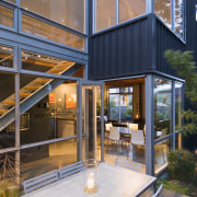 Exterior view of the paved courtyard with glazing, architecture, home, house, real estate, brown