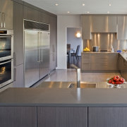 View of a remodelled open kitchen which features cabinetry, countertop, cuisine classique, home appliance, interior design, kitchen, real estate, room, gray