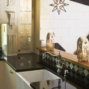 Image of kitchen designed by Debra DeLorenzo which countertop, home, interior design, kitchen, room, under cabinet lighting, white, black