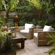 View of a small shaded garden which features backyard, courtyard, furniture, garden, landscaping, outdoor furniture, outdoor structure, patio, real estate, table, yard, brown