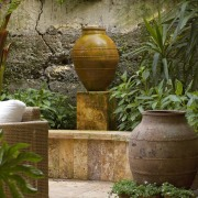 View of a custom made water feature which arecales, flowerpot, garden, landscaping, outdoor structure, plant, brown
