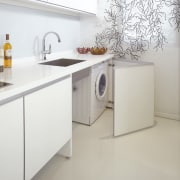 The sleek cabinetry features a white laminate with countertop, floor, furniture, home appliance, kitchen, major appliance, product, product design, sink, tap, gray, white