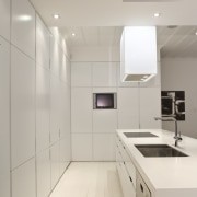 View of kitchen which features a kitchen island architecture, cabinetry, countertop, floor, interior design, kitchen, product design, room, sink, gray