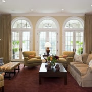 View of the family room which features sofas ceiling, estate, home, interior design, living room, real estate, room, window, gray