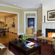 View of the family room which features sofas ceiling, estate, hearth, home, interior design, living room, real estate, room, suite, white