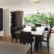 View of dining area featuring large dark stained dining room, interior design, room, table, white