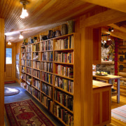 View of the central spine that runs through antiquarian, bookcase, bookselling, interior design, library, public library, shelving, wood, brown