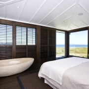 View of master bedroom which has a stone bedroom, ceiling, interior design, real estate, room, window, window covering, window treatment, wood, white, black