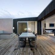View of the central courtyard which features decking, apartment, architecture, floor, house, interior design, penthouse apartment, property, real estate, gray