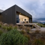 Exterior view of the fron of the beach architecture, cottage, estate, facade, home, house, property, real estate, sky, brown, teal, black
