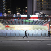 View of the new TKTS ticketing booth in advertising, building, city, crowd, downtown, infrastructure, landmark, metropolis, metropolitan area, night, pedestrian, pedestrian crossing, street, urban area, black