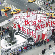 View of the new TKTS ticketing booth in city, crowd, white, gray