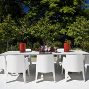 View of patio with water and sun resistant chair, furniture, outdoor furniture, patio, table, white, brown