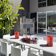 View of patio with water and sun resistant chair, flowerpot, furniture, home, interior design, plant, table, gray, black