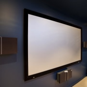 View of a home theatre screen and audio computer monitor, display device, flat panel display, interior design, led backlit lcd display, multimedia, projection screen, projector accessory, screen, technology, black