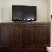 Image of television cabinet which has been designed cabinetry, chest of drawers, furniture, hardwood, sideboard, wood, wood stain, gray, red