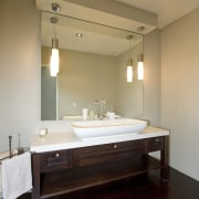 Image of the bathroom which the vanities have bathroom, ceiling, floor, flooring, interior design, lighting, room, sink, orange, black