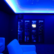 View of home cinema with projector screen, audiovisual blue, ceiling, display device, light, lighting, purple, technology, blue
