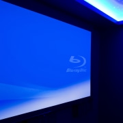 View of projector screen in home theatre. - blue, computer wallpaper, display device, flat panel display, led backlit lcd display, light, lighting, multimedia, projection screen, sky, technology, blue