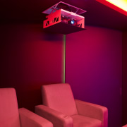 View of home cinema with projector, audiovisual and ceiling, interior design, light, light fixture, lighting, red, red