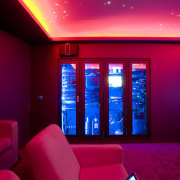 View of home cinema with projector screen, audiovisual ceiling, display device, interior design, light, lighting, purple, red