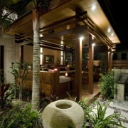 View of outdoor area with landscaping, decking, outdoor home, house, landscape lighting, lighting, outdoor structure, real estate, brown, black