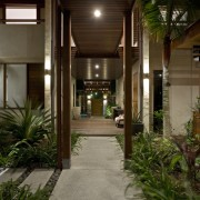 View of the covered breezeway which runs from condominium, courtyard, estate, home, house, lighting, real estate, walkway, brown