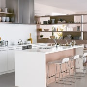 View of a kitchen which features surfaces from cabinetry, countertop, cuisine classique, furniture, interior design, kitchen, product design, table, gray, white