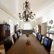 View of dining area featuring a wrought iron ceiling, dining room, home, interior design, living room, property, real estate, room, white