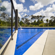 Exterior view of house which features a pool cloud, estate, leisure, property, real estate, sky, swimming pool, water, white