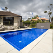 Exterior view of house which features a pool backyard, estate, home, house, leisure, property, real estate, residential area, resort, swimming pool, villa, white, gray