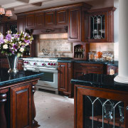 View of a kitchen which features cabinetry available cabinetry, countertop, cuisine classique, furniture, hardwood, home, interior design, kitchen, room, black, gray